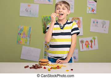 Boy addicted to fastfood - Image of small boy addicted to...