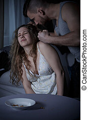 Man pulling womans hair - Young aggressive angry man pulling...