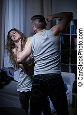 Choking defenseless woman - Strong brutal man choking young...