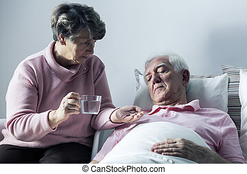 Disabled senior and his wife - Image of disabled senior man...