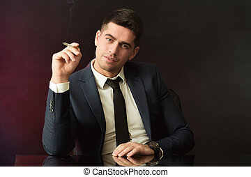 Boss with smirk smoking cigarette - Image of boss with smirk...