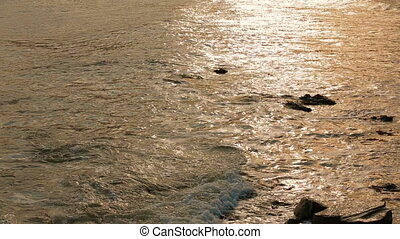 Sea Waves Washing Rocky Shore At Sunset