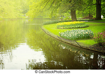 spring garden Keukenhof, Netherlands - Colorful river in...