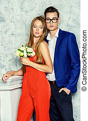 wedding - Gorgeous couple of young people stand in a room...