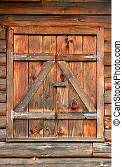 Closed Window Shutters of Log Home - Close up of wood...