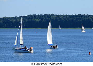 Lake and sailboats - Yachts sailing on the lake under...