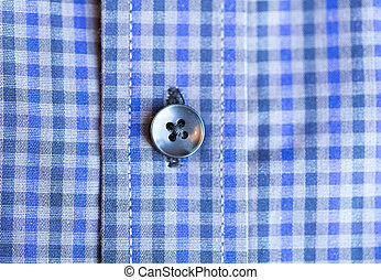 Shirt Button Close Up on blue and white shirt