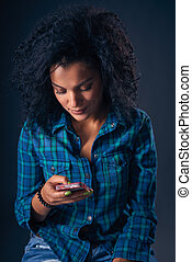 Woman texting on her cell phone