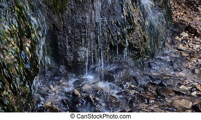 fresh water stream with waterfall in mountain forest