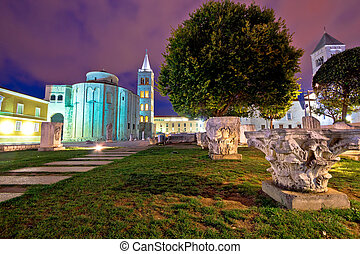 Zadar historic square evening view with old Roman artefacts,...