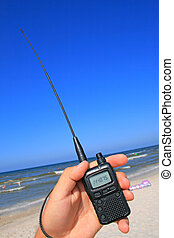 Walkie talkie in a hand - VHF transceiver in a hand against...