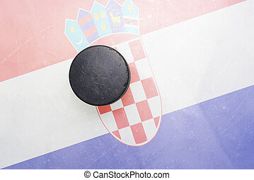 old hockey puck is on the ice with croatia flag - vintage...