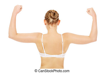 Back view of athletic woman show her muscles
