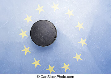 old hockey puck is on the ice with european union flag -...