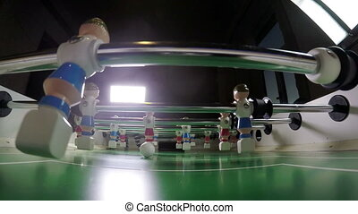Toy football players. The goalkeeper misses the goal. Slow...