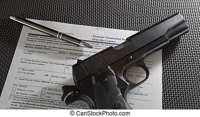 Gun transfer - Handgun and pen on the paperwork required for...