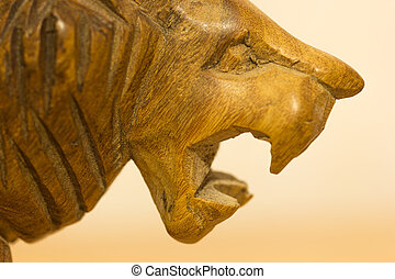 Macro of wooden lion roaring
