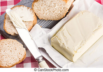 fresh butter and bread - fresh butter, knife and bread with...
