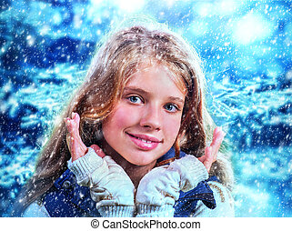 Winter woman catch snowflakes.