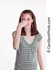 Oh, Stinky! - a young teenage girl holding her nose in...