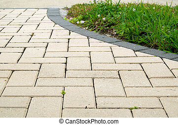 alternating rectangular pavers - Low angle view of light...