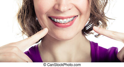 Beautiful smiling girl wearing braces. - Beautiful smiling...