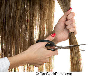 scissors trying to cut long hair - Close-up hands holding...