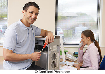 Computer IT Support Worker Fixing Machine In Office