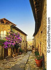 Castiglione della Pescaia, old street on sunset. Maremma...