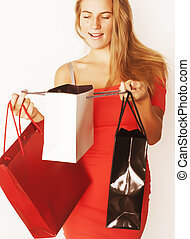 young pretty blond woman with bags