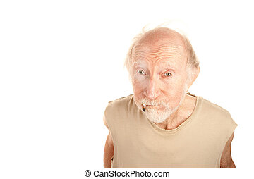 Senior man smoking cigarette - Senior man in ragged shirt...