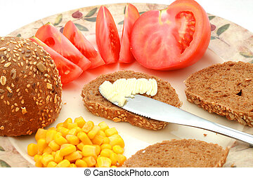 Healthy breakfast - Whole-meal roll with butter, corn and...
