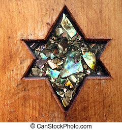Shield of David or Star of David curved on wood decorated...