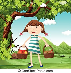 Girl with basket of food in the field