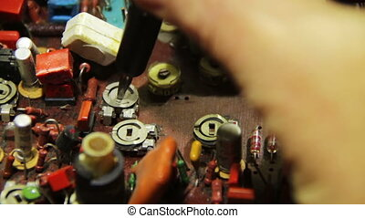 Radio engineer configures the electric circuit - Close-up of...
