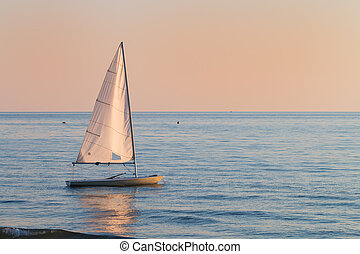 small sailboat in the water next to the beach - small...