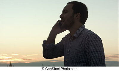 Businessman talking on phone view with sunlight