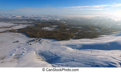 Aerial shot of ski resort, mountains, and town.
