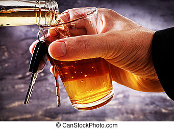 man holding car key and glass with alcohol - man holding...