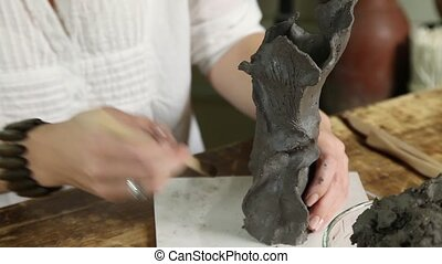 Sculptor Hands Working Close-up - Sculptor woman shaping...