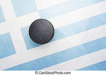 old hockey puck is on the ice with greece flag - vintage old...