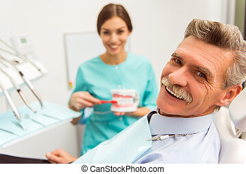 Professional dentist office - Elderly man on a review of a...