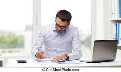 busy businessman with laptop and papers in office -...