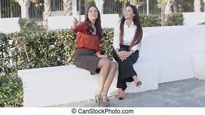 Two women relaxing and having a chat