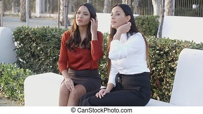 Young woman explaining something to a friend gesturing with...