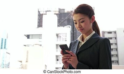 Woman Texting Message With Phone