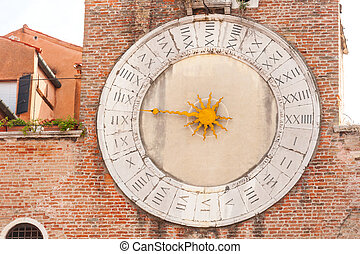 Old clock of the Church in Venice