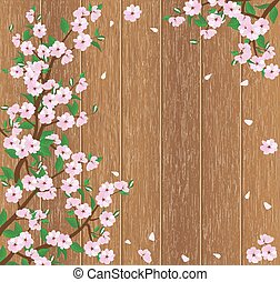 flowering tree branch on a wooden background