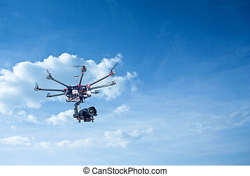 Octocopter, copter, drone - Copter shoots in flight on a...