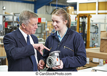Factory Manager And Engineering Apprentice Discussing...